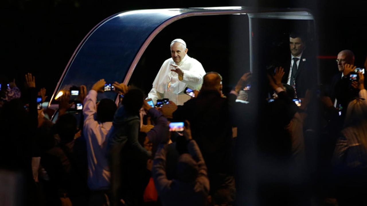 Pope Francis waves from the pope mobile during the Papal Parade at the Festival of Families, Saturday, Sept. 26, 2015, in Philadelphia. AP Photo/Matt Rourke, Pool