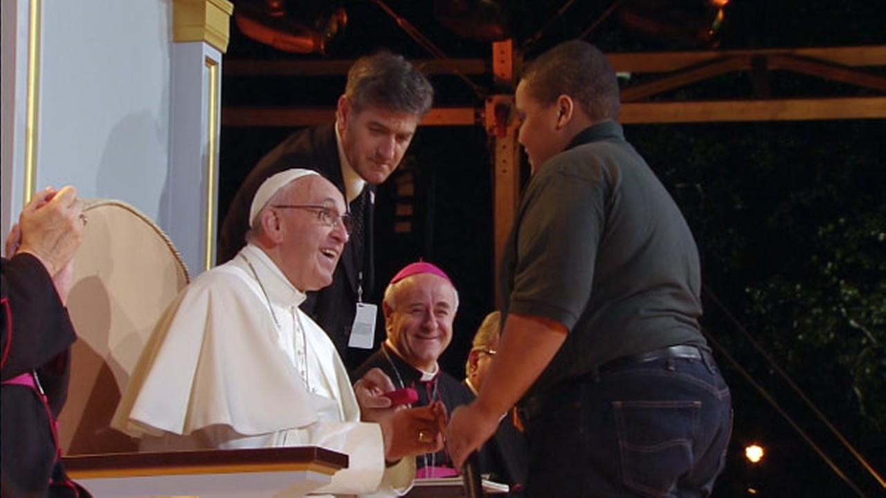 A member of the Keystone Boys Choir presents a gift to Pope Francis at the Festival of Families in Philadelphia on September 26, 2015.