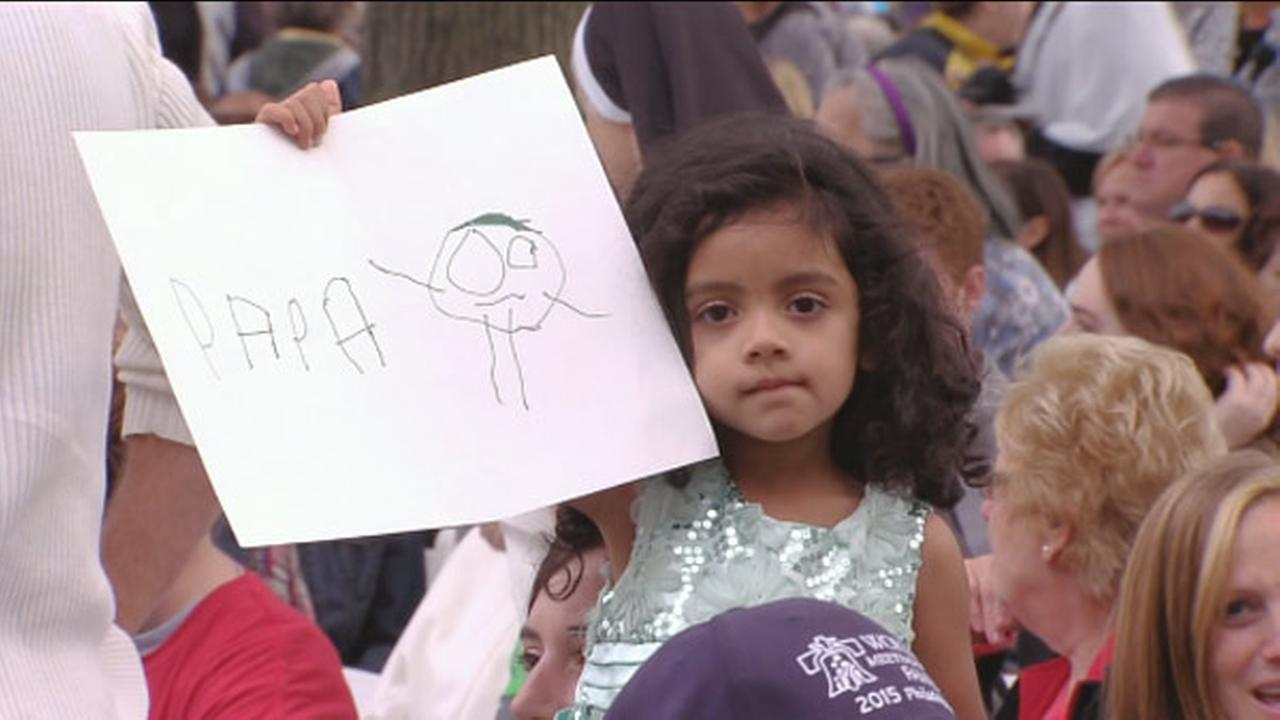 A young girl is shown during the papal parade prior to the papal Mass in Philadelphia.