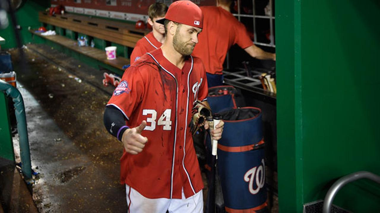 Washington Nationals Bryce Harper (34) gestures and walks along the dugout after a baseball game against the Philadelphia Phillies, Saturday, Sept. 26, 2015, in Washington.