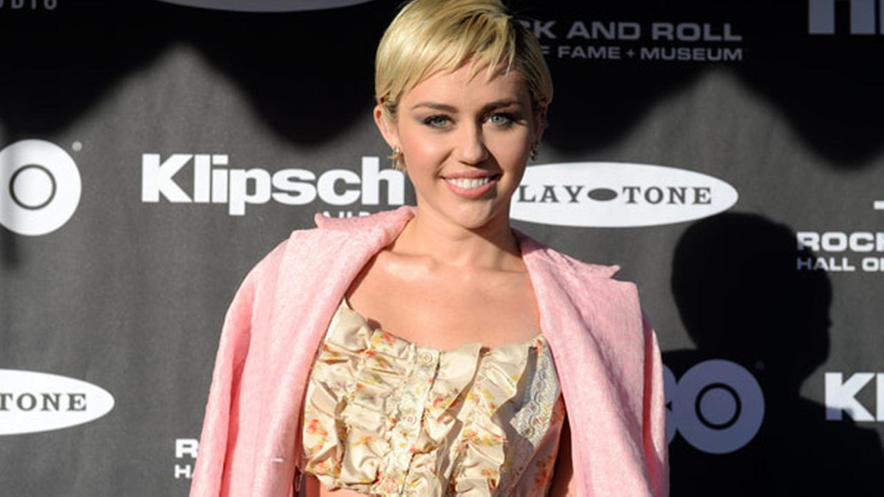 FILE - In this April 18, 2015 file photo, Miley Cyrus arrives at the 2015 Rock and Roll Hall of Fame Induction Ceremony at Public Hall in Cleveland, Ohio.