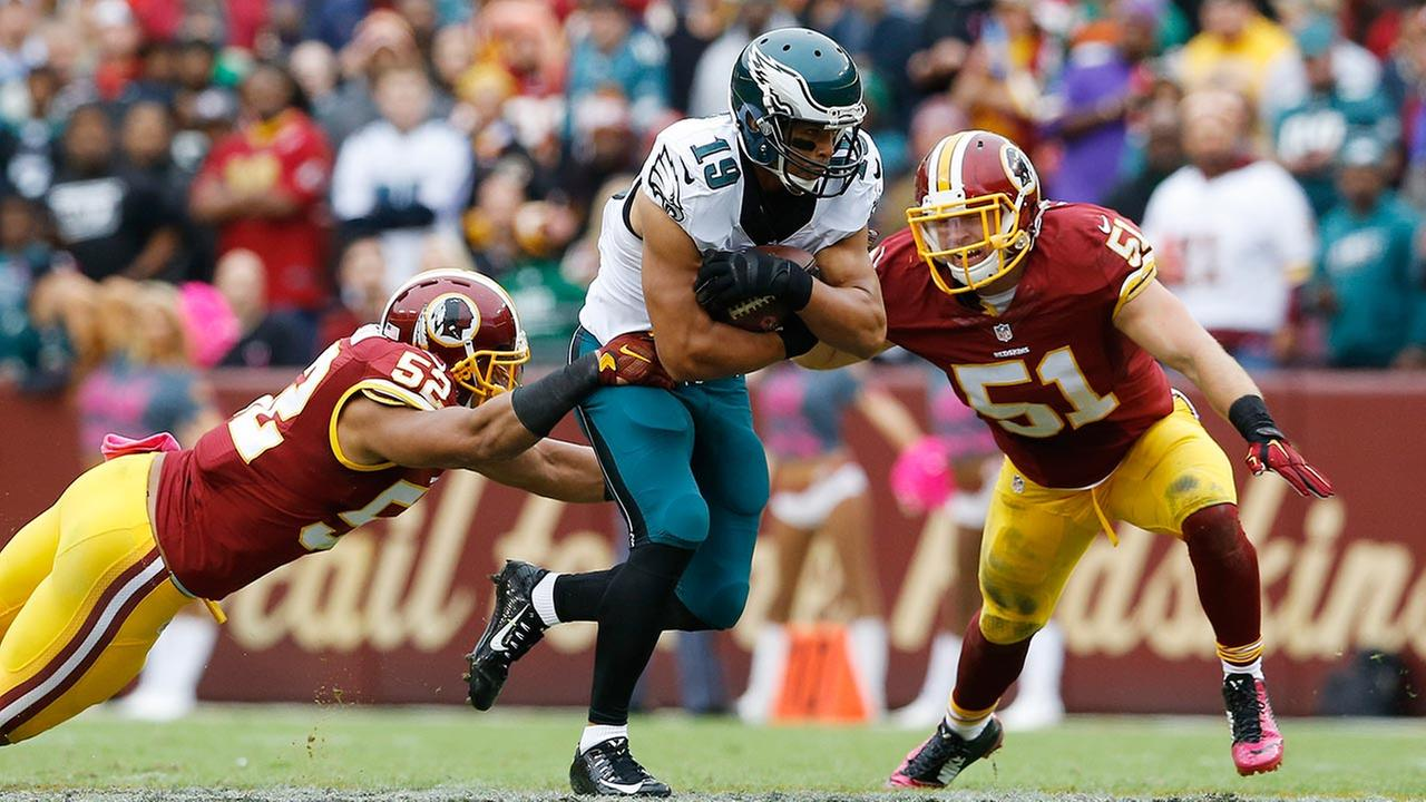 Philadelphia Eagles wide receiver Miles Austin (19) tries to run between defenders Washington Redskins inside linebacker Keenan Robinson (52) and Washington Redskins inside linebac