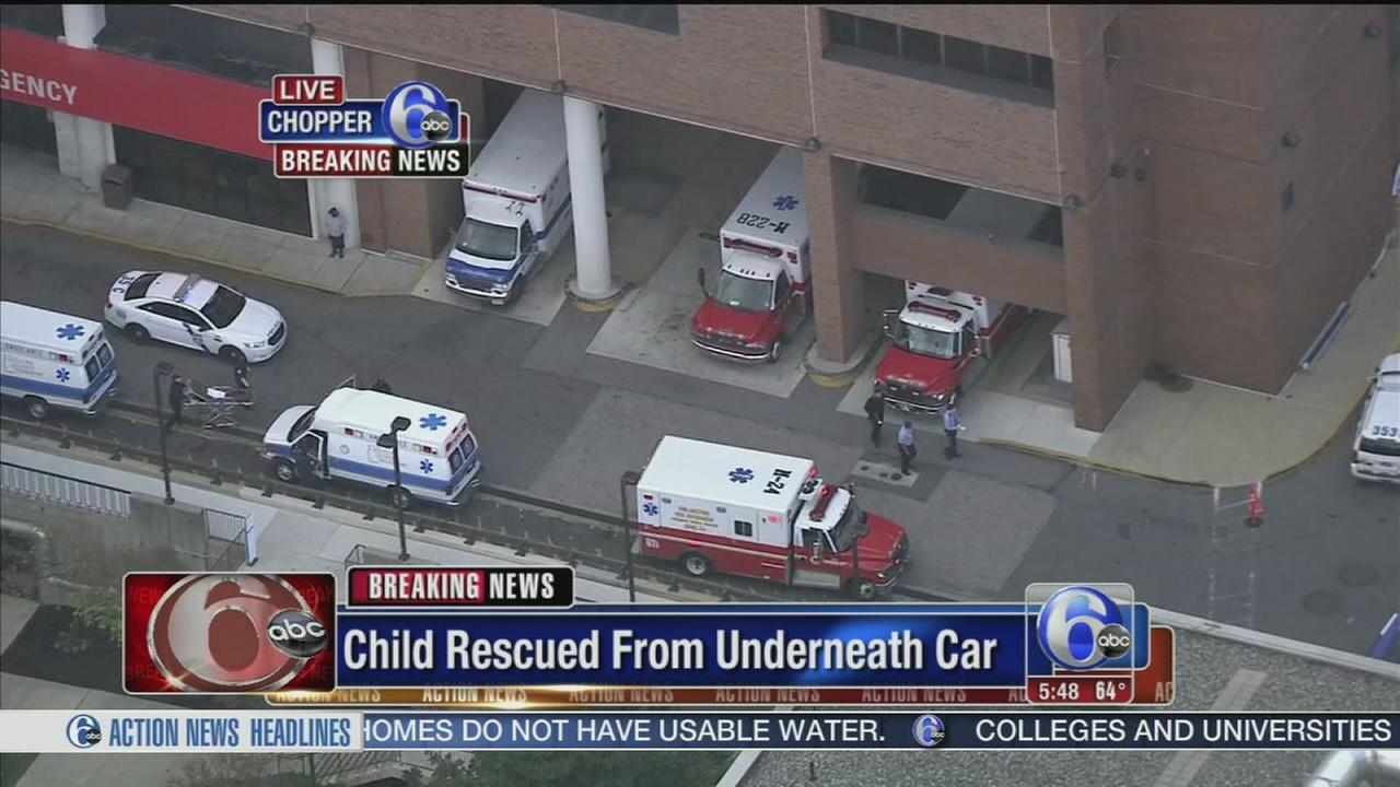 VIDEO: Child rescued from underneath car
