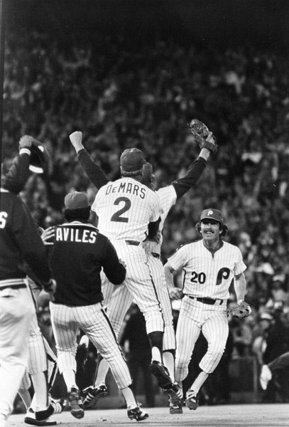 <div class='meta'><div class='origin-logo' data-origin='none'></div><span class='caption-text' data-credit=''>Philadelphia Phillies third baseman Mike Schmidt (20) races to celebrate with Phillies relief pitcher Tug McGraw, arms upraised, and coach Billy DeMars .</span></div>