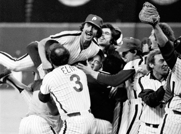 <div class='meta'><div class='origin-logo' data-origin='none'></div><span class='caption-text' data-credit='Photo/Anonymous'>In this Oct. 21, 1980 file photo, Philadelphia Phillies third baseman Mike Schmidt, top left, leaps onto teammates after the Phillies defeated the Kansas City Royals.</span></div>