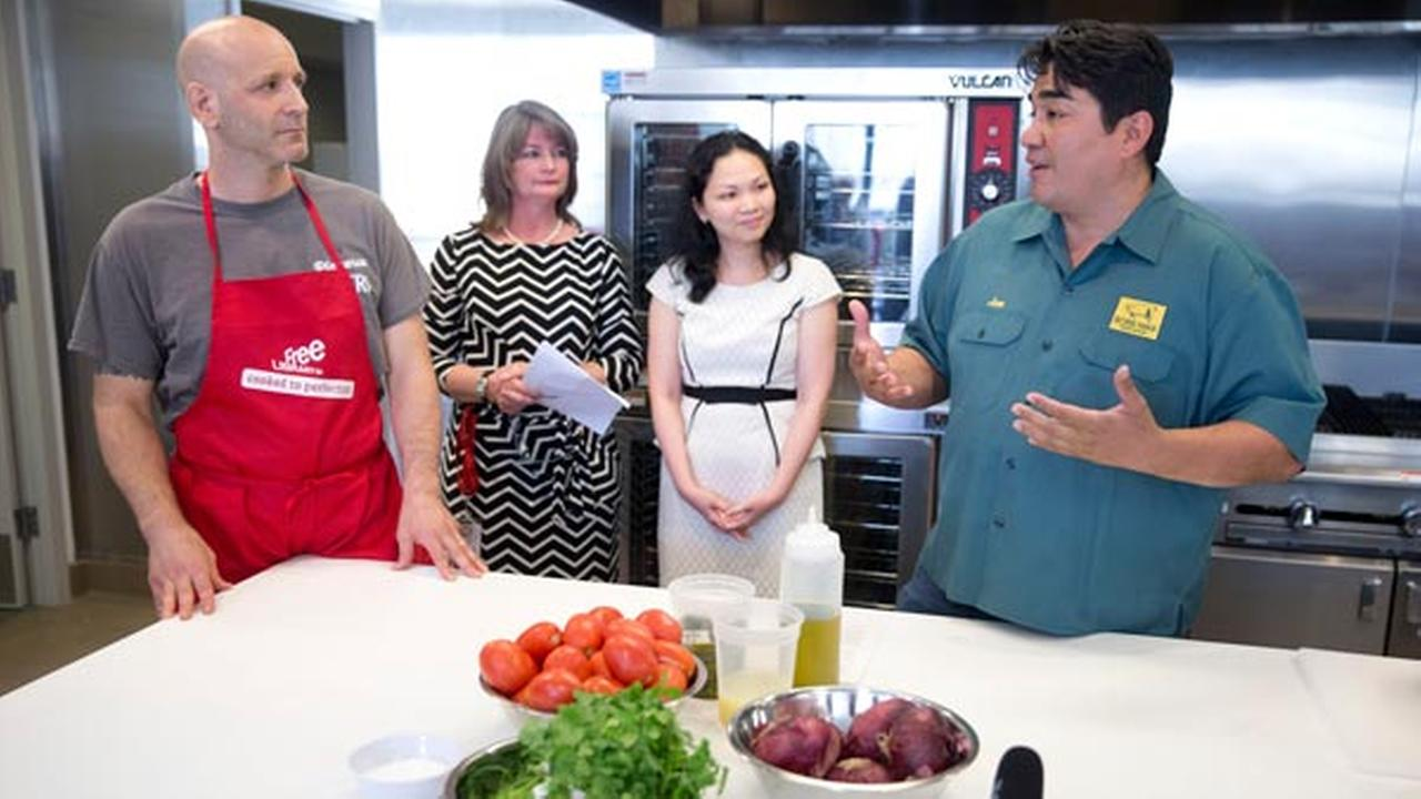 Chef Jose Garces, right, accompanied by from the left, chef Marc Vetri, library president and director Siobhan Reardon, and Nhu Huynh with the Cancer Treatment Centers of America.