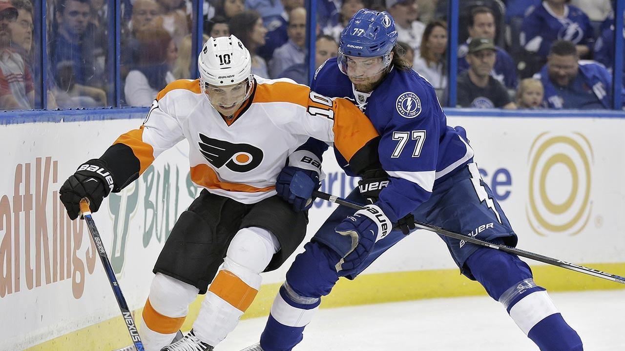 Philadelphia Flyers center Brayden Schenn (10) battles with Tampa Bay Lightning defenseman Victor Hedman (77), of Sweden, for the puck during the first period of an NHL hockey game