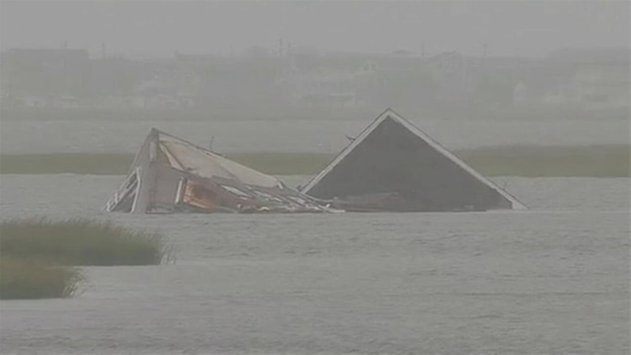 Coast Guard: Owner must pay to salvage home swept into bay
