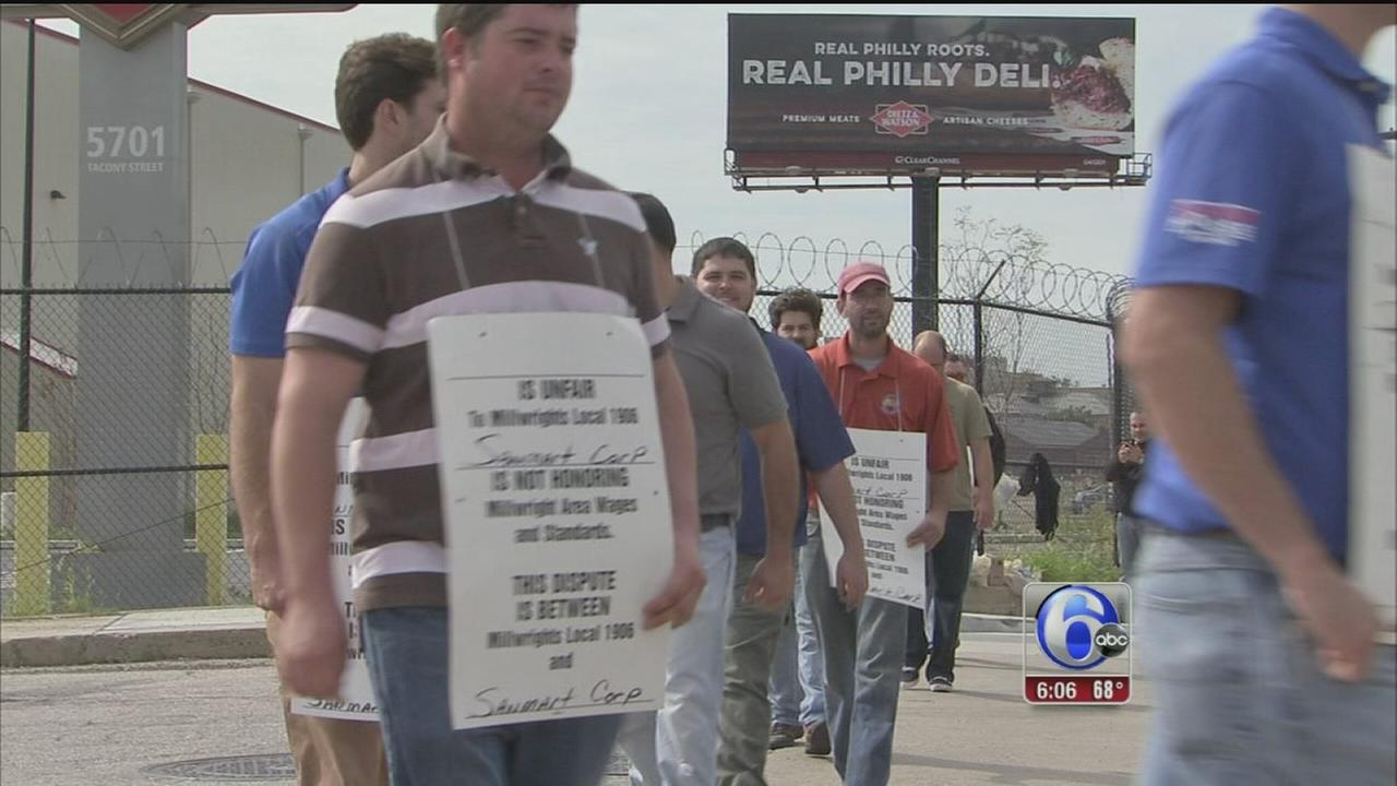 VIDEO: Picketers struck by vehicle