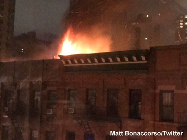 <div class='meta'><div class='origin-logo' data-origin='none'></div><span class='caption-text' data-credit=''>A firefighter lowered from the roof of a burning Upper East Side apartment building rescued a man during a six-alarm fire that killed one person.</span></div>