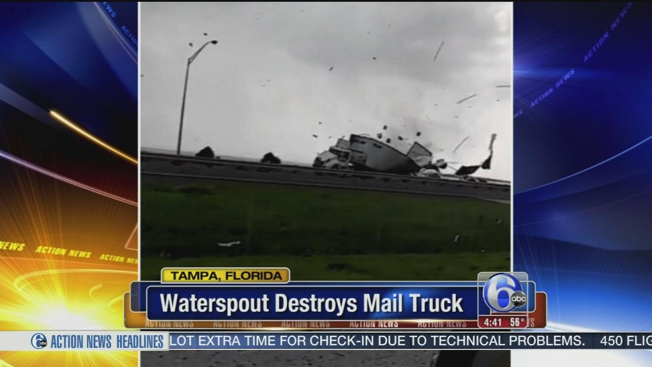 VIDEO: Water spout destroys mail truck
