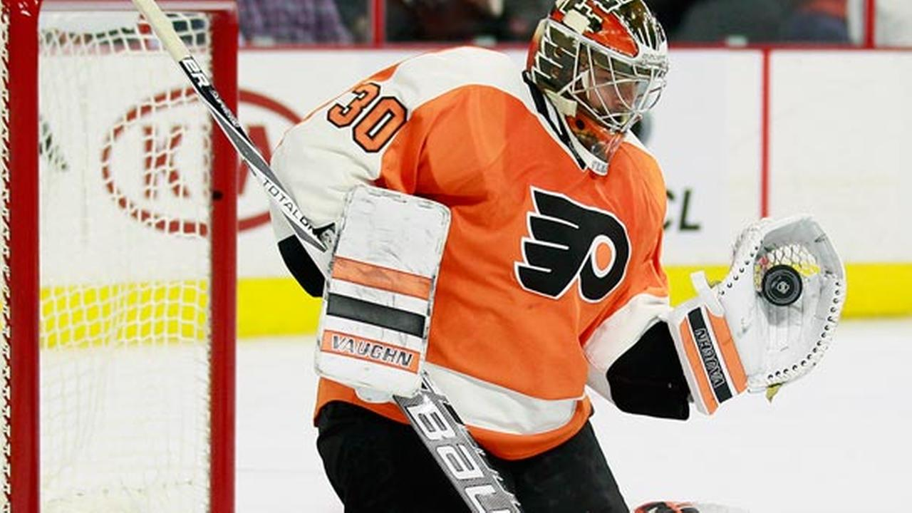 Philadelphia Flyers Michal Neuvirth gloves a shot on goal during the first period of an NHL hockey game against the Florida Panthers, Monday, Oct. 12, 2015, in Philadelphia.