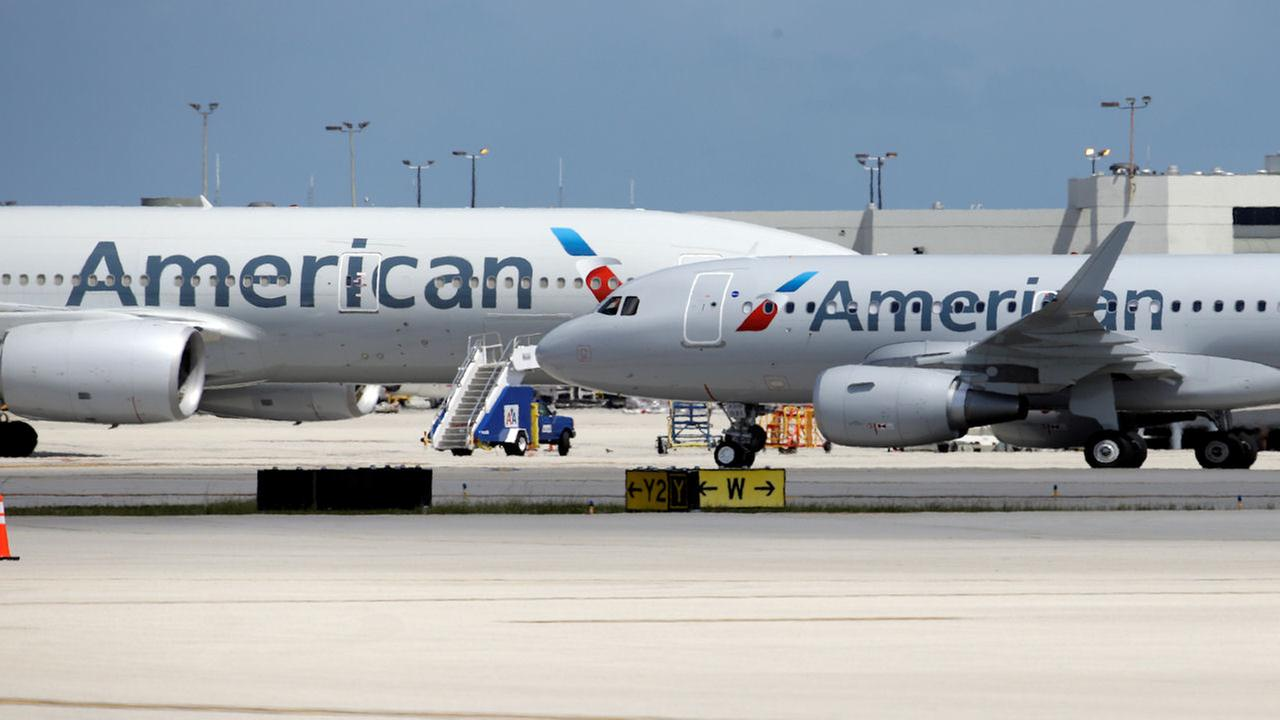 FILE - American Airline planes