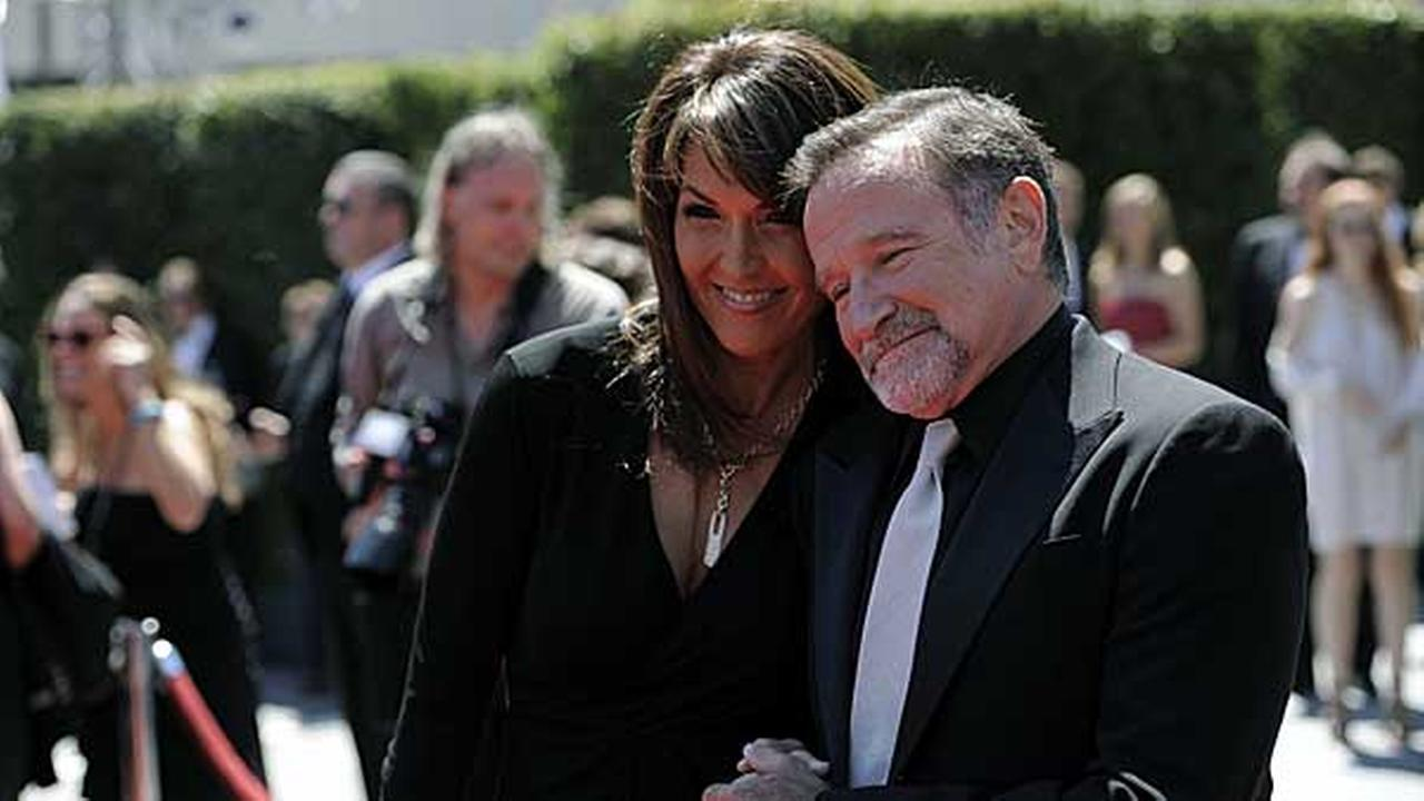 FILE - Robin Williams, right, and Susan Schneider arrive at the Creative Arts Emmy Awards on Saturday, Aug. 21, 2010 in Los Angeles.