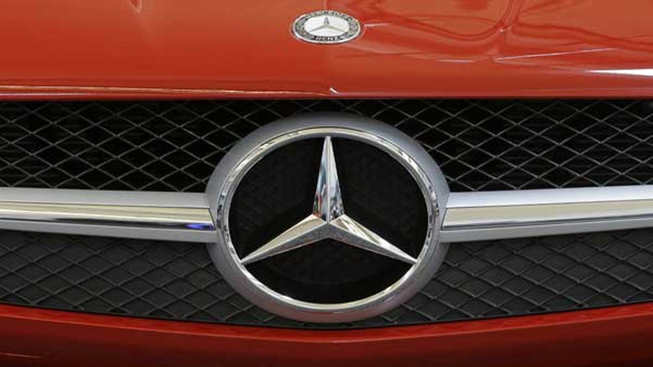 This photo taken Feb. 14, 2013 shows a Mercedes logo on the grill of a Mercedes automobile at the 2013 Pittsburgh Auto Show in Pittsburgh.