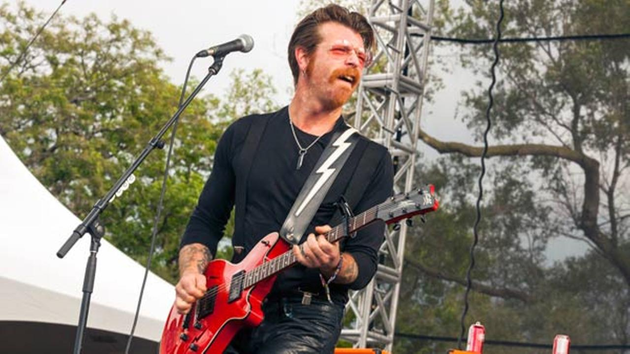 FILE - In this Sept. 11, 2015 file photo, Jesse Hughes of Eagles of Death Metal performs at Riot Fest and Carnival in Douglas Park in Chicago.