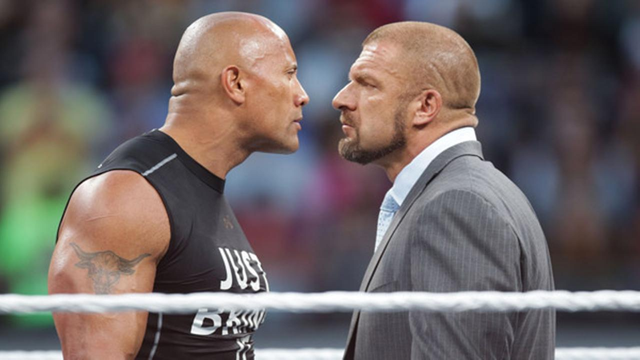 FILE: Dwayne the Rock Johnson stares off against WWE superstar Triple H at WrestleMania 31 on Sunday, March 29, 2015 in Santa Clara, CA.