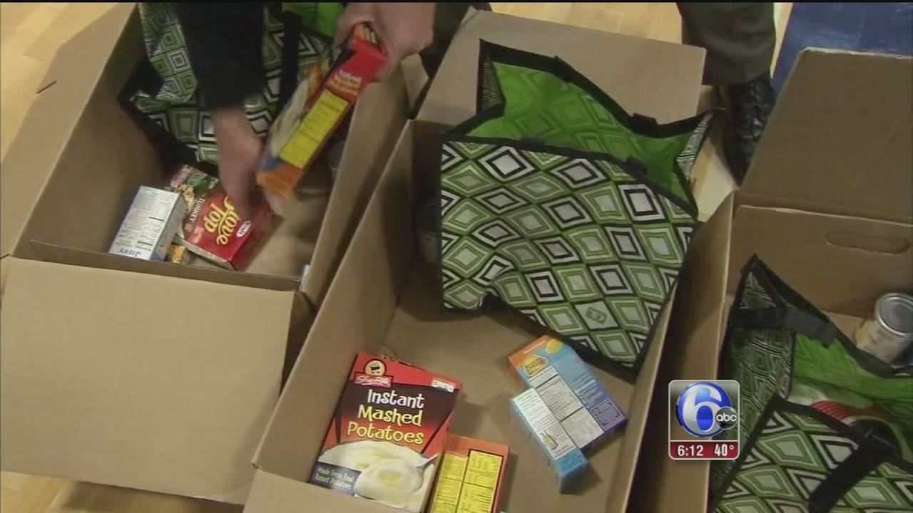VIDEO: NJ State Police load up Thanksgiving baskets
