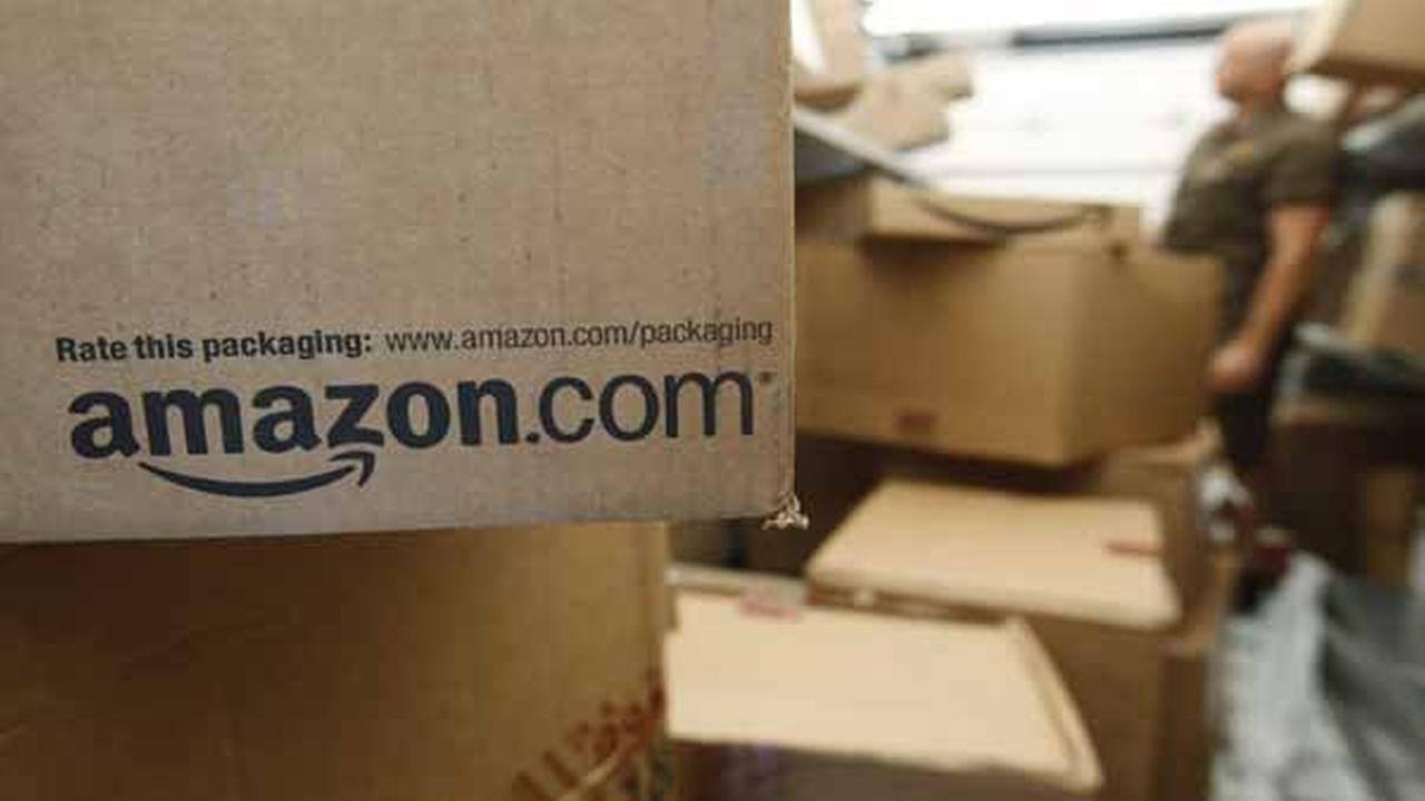 FILE - In this Oct. 18, 2010 file photo, an Amazon.com package awaits delivery from UPS in Palo Alto, Calif. Amazon on Thursday, March 13, 2014.