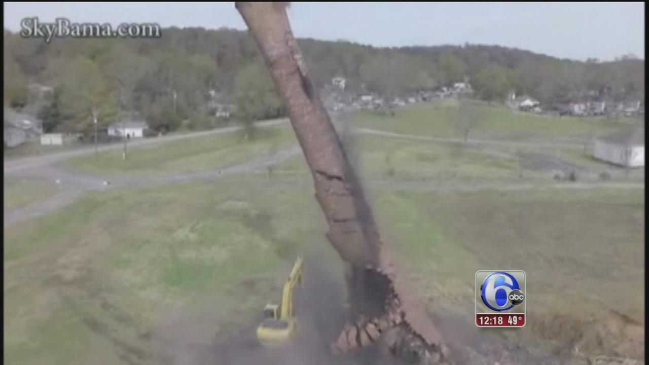 VIDEO: Man survives after smokestack crashes over him during demolition