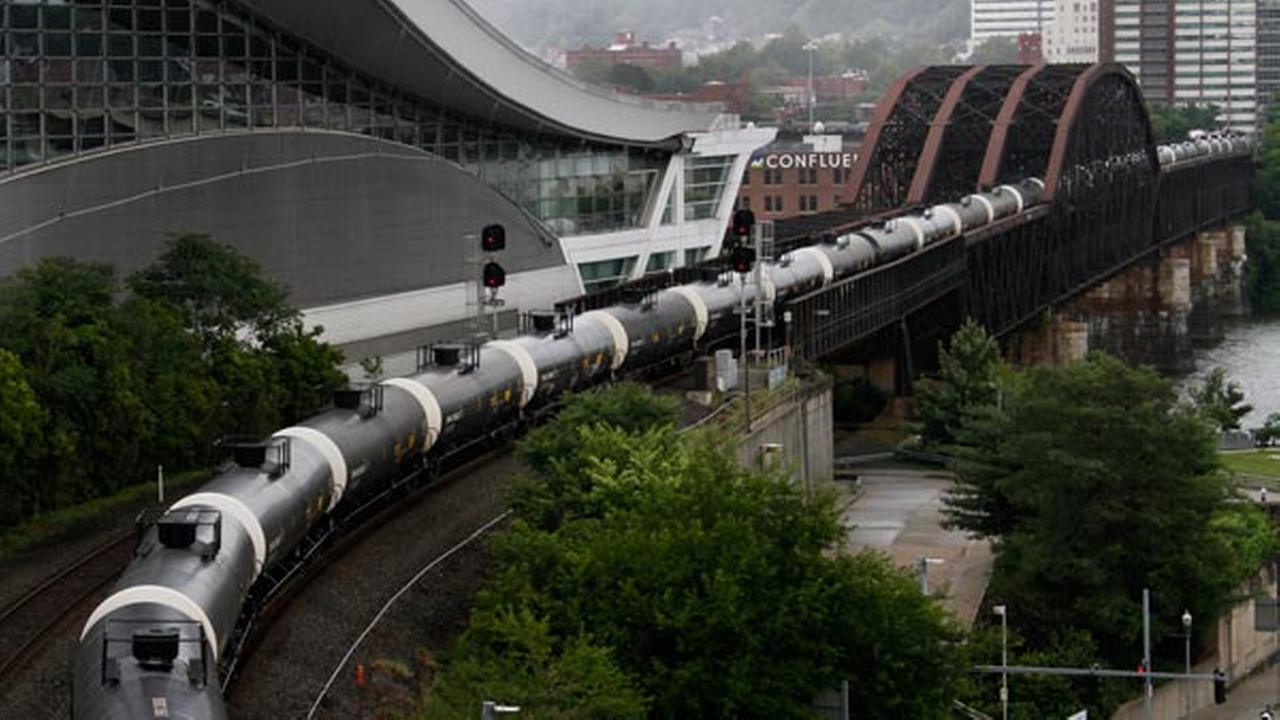 FILE: Tank cars on a Norfolk Southern freight train roll through downtown Pittsburgh, Monday, July 28, 2014.