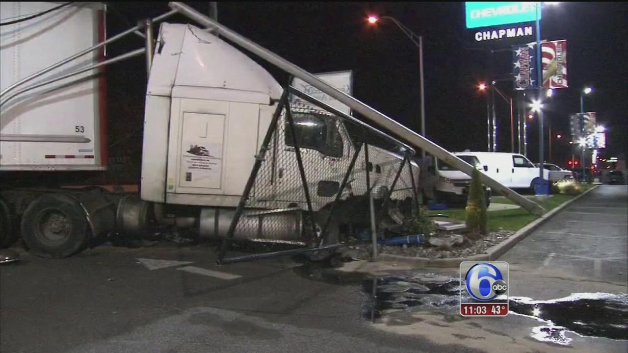VIDEO: Tractor trailer crashes into pole