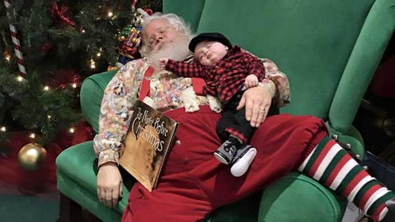 In this Nov. 25, 2015 photo provided by Donnie Walters  son Zeke snuggles up on Santas lap during a visit to a shopping mall in Evansville, Indiana.