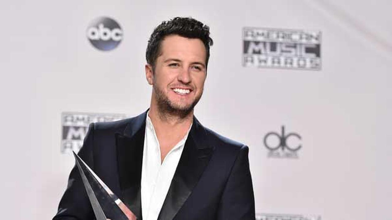 Luke Bryan poses in the press room with the award for favorite male artist - country at the American Music Awards at the Microsoft Theater on Sunday, Nov. 22, 2015.