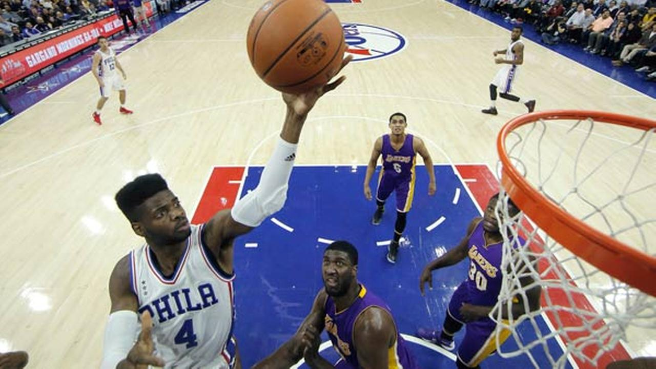 Philadelphia 76ers Nerlens Noel goes up for a shot against Los Angeles Lakers Roy Hibbert during the first half of an NBA basketball game, Tuesday, Dec. 1, 2015, in Philadelphia.