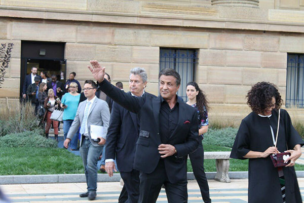 <div class='meta'><div class='origin-logo' data-origin='none'></div><span class='caption-text' data-credit=''>Pictured: Sylvester Stallone with the cast and crew of 'Creed' at the Art Museum in Philadelphia.</span></div>