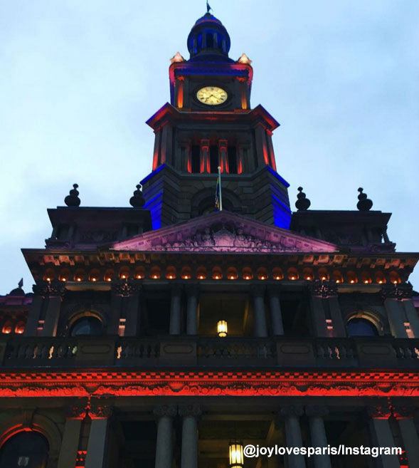 <div class='meta'><div class='origin-logo' data-origin='none'></div><span class='caption-text' data-credit=''>Sydney Townhall is lit in the colors of the French flag.</span></div>