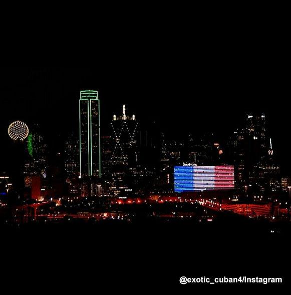 <div class='meta'><div class='origin-logo' data-origin='none'></div><span class='caption-text' data-credit=''>The Omni Hotel Dallas is lit blue, white and red.</span></div>