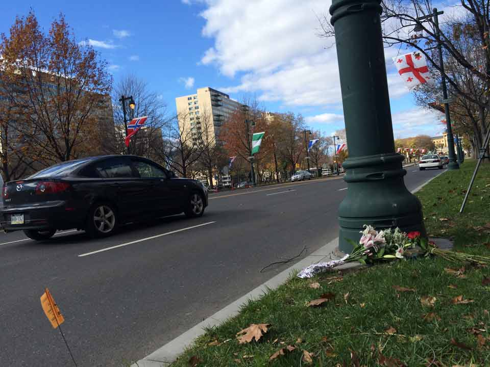 <div class='meta'><div class='origin-logo' data-origin='WPVI'></div><span class='caption-text' data-credit=''>Flowers and a candle are placed at the base of the French flagpole on the Ben Franklin Parkway on Saturday, Nov. 14.</span></div>
