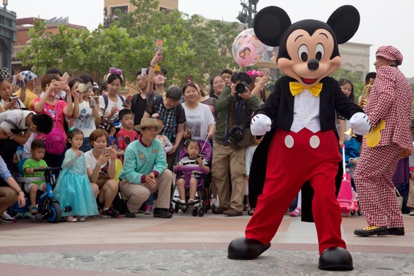 <div class='meta'><div class='origin-logo' data-origin='none'></div><span class='caption-text' data-credit='AP Photo/Ng Han Guan'>Mickey Mouse entertains visitors on the opening day of the Disney Resort in Shanghai, China, Thursday, June 16, 2016.</span></div>