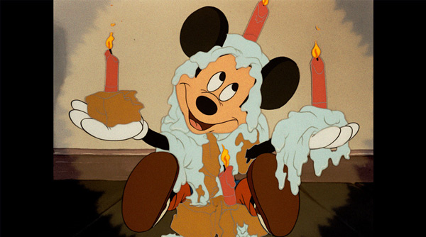 <div class='meta'><div class='origin-logo' data-origin='none'></div><span class='caption-text' data-credit='Disney'>Mickey celebrates his day with a little cake and candles.</span></div>
