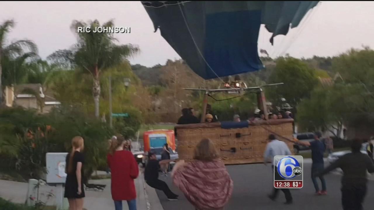 VIDEO: Neighbors rescue hot air balloon