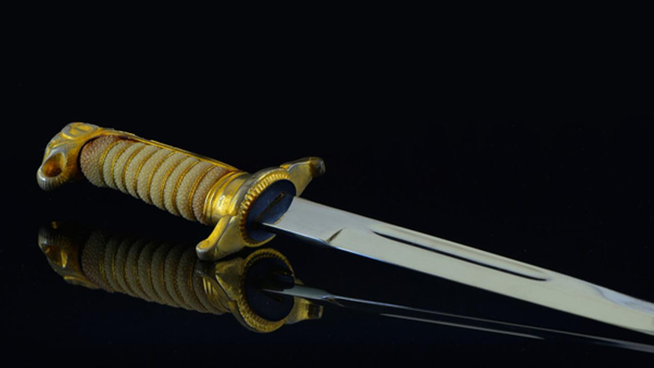 An image of a sword is shown - not the sword used in the incident.