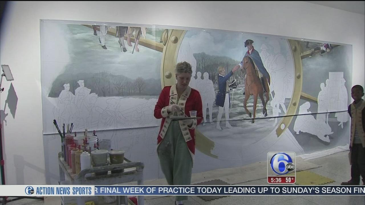 VIDEO: Muralist paints for public