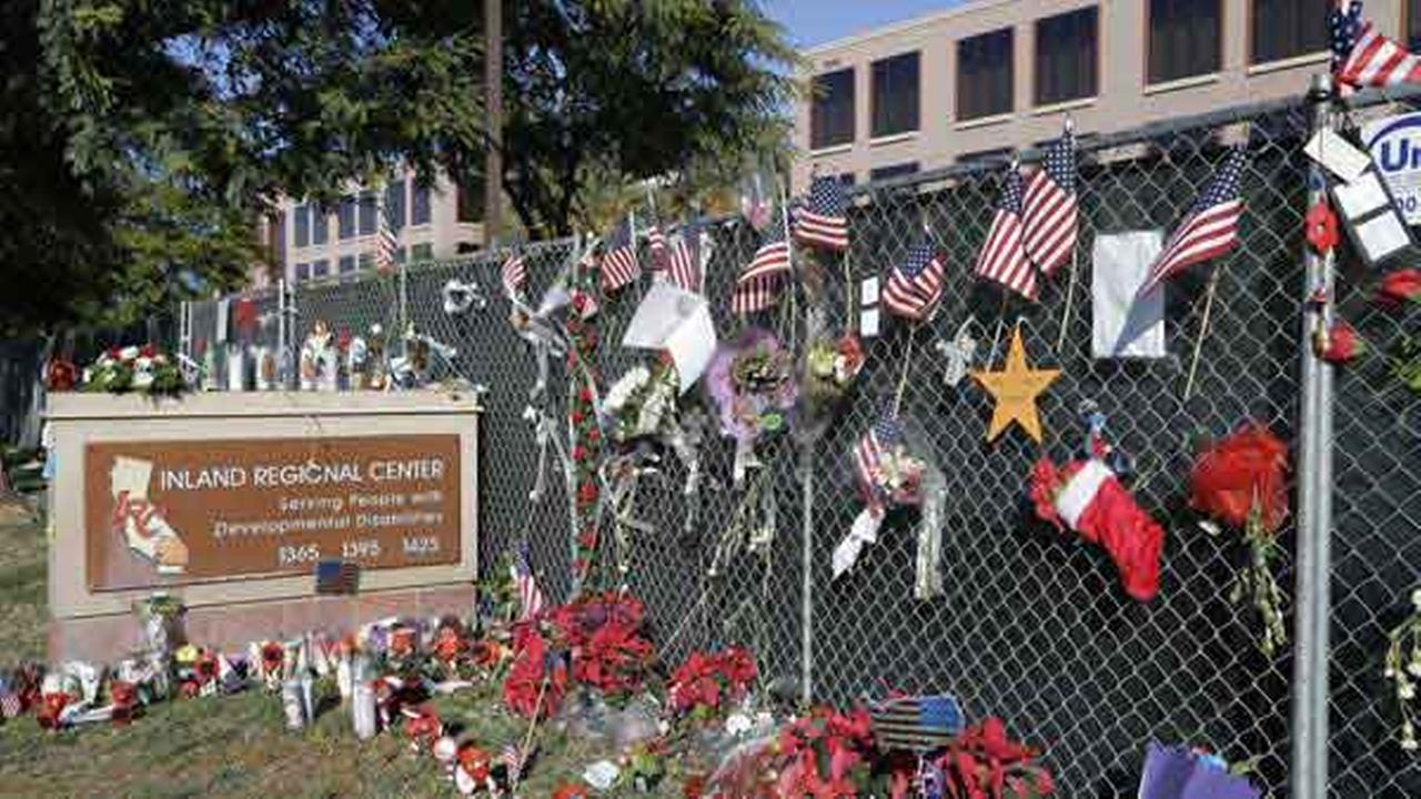 Flowers and American flags honoring the victims of the attack on Dec. 2 are placed outside the Inland Regional Center where the fatal shooting took place in San Bernardino, Calif.