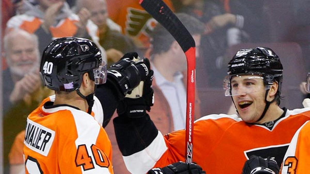 Philadelphia Flyers Luke Schenn, right, celebrates his goal with Vincent Lecavalier during the second period of a hockey game against the New Jersey Devils.