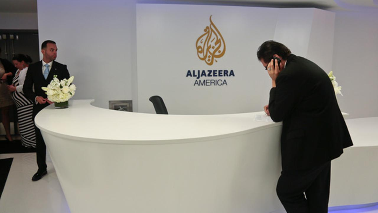 Visitors wait in the lobby of Al-Jazeera America after the networks first broadcast on Tuesday, Aug. 20, 2013 in New York.