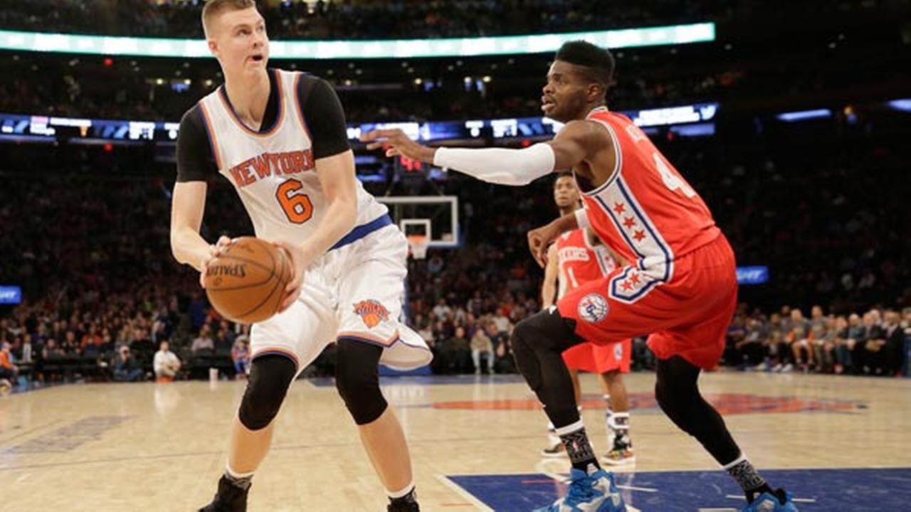 New York Knicks Kristaps Porzingis, left, looks for a shot past Philadelphia 76ers Nerlens Noel during the second half of the NBA basketball game.