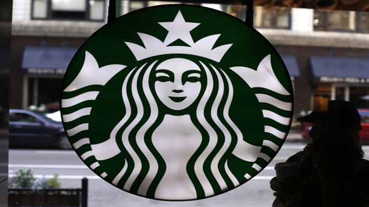 In this Saturday, May 31, 2014 photo, the Starbucks logo is seen at one of the companys coffee shops in downtown Chicago.