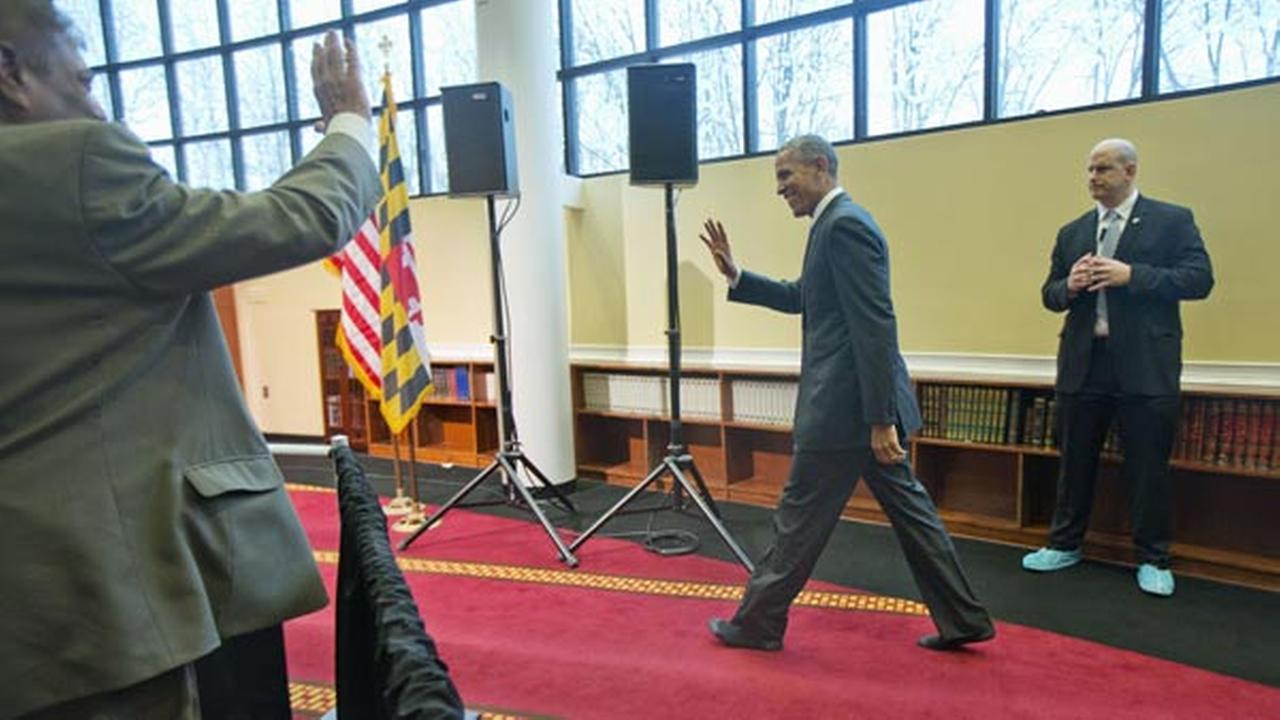 President Barack Obama walks in his socks towards the podium before speaking to members of the Muslim-American community at the Islamic Society of Baltimore, Wednesday.