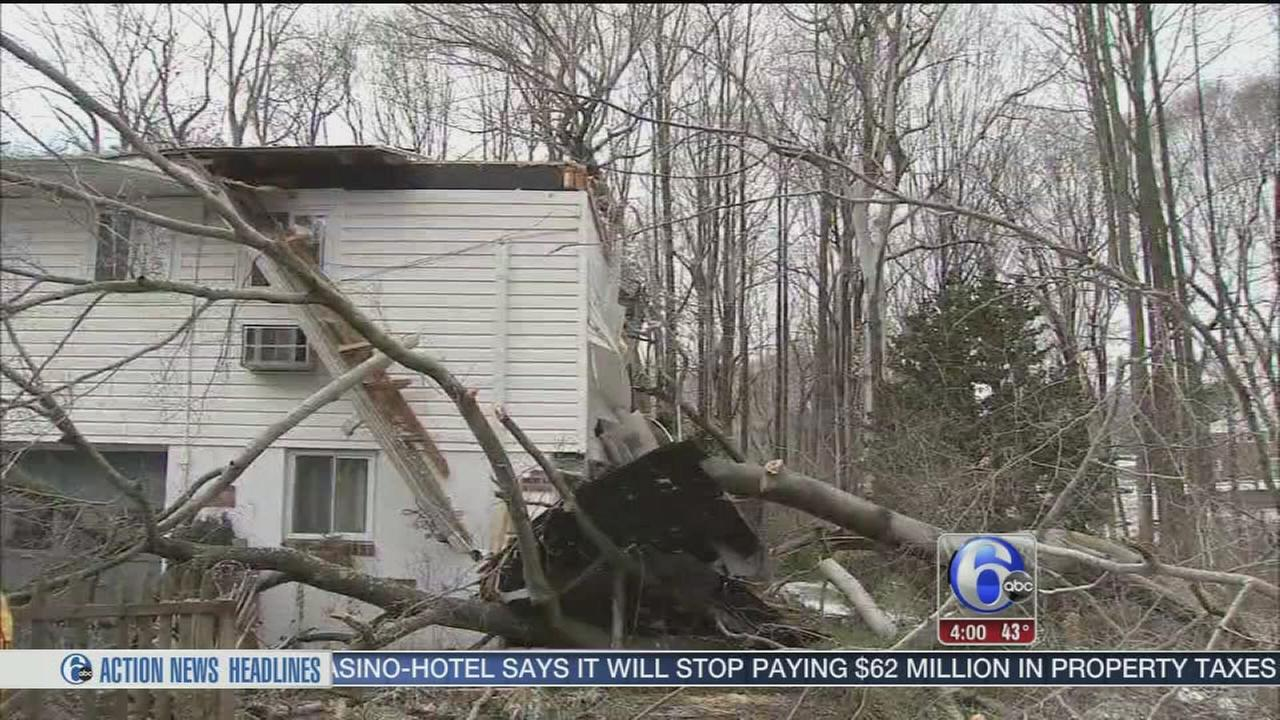 VIDEO: Woman killed, man rescued after tree falls on home