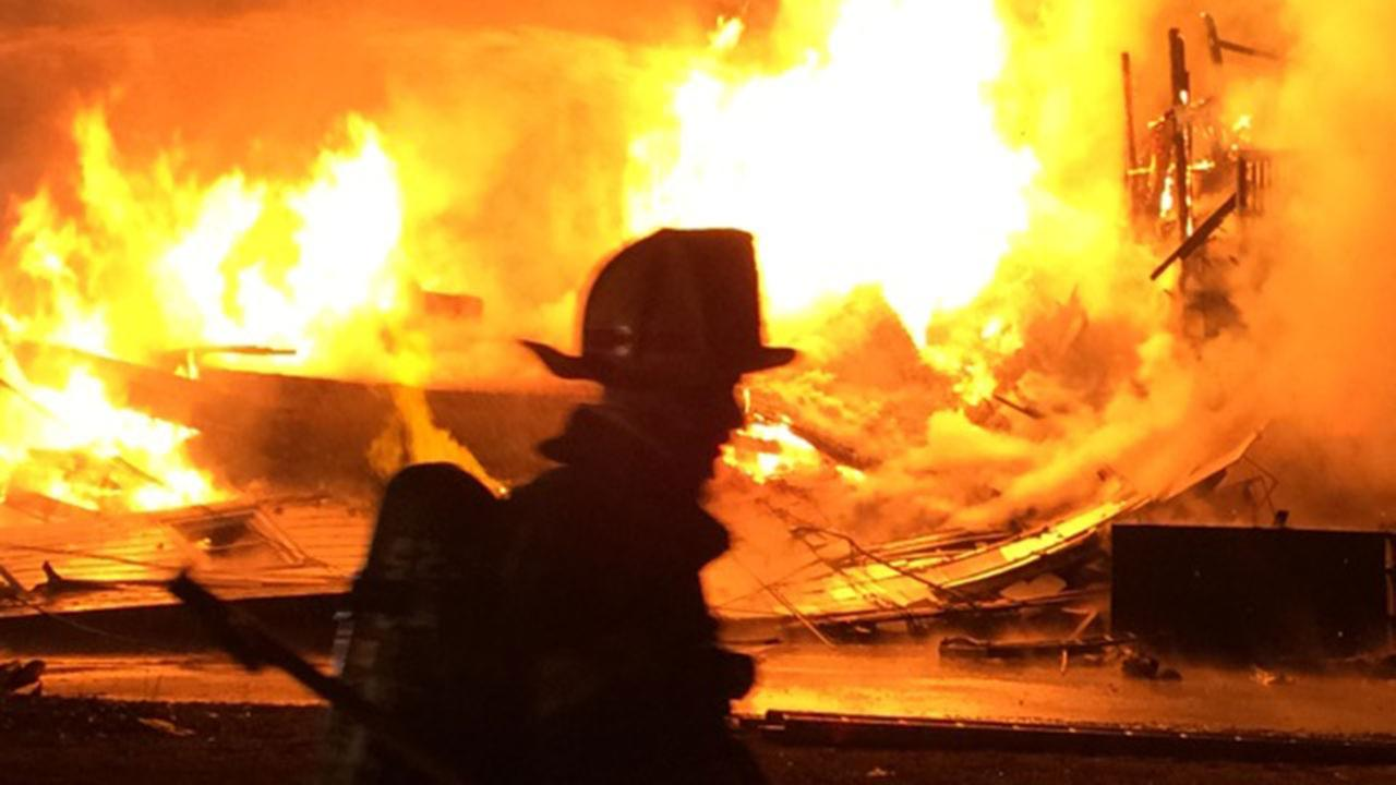 Fire crews are battling a three-alarm blaze in Cumberland County.