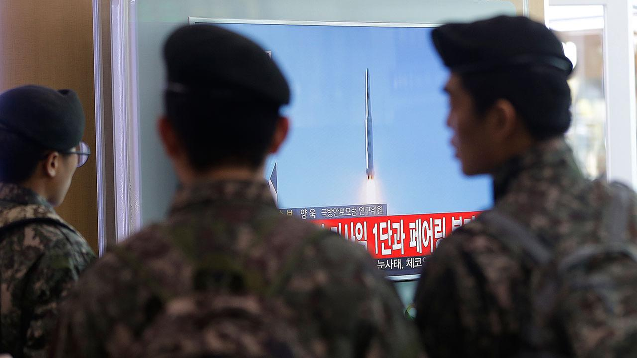 South Korean army soldiers watch a TV news program with a file footage about North Koreas rocket launch at Seoul Railway Station in Seoul, South Korea, Sunday, Feb. 7, 2016.