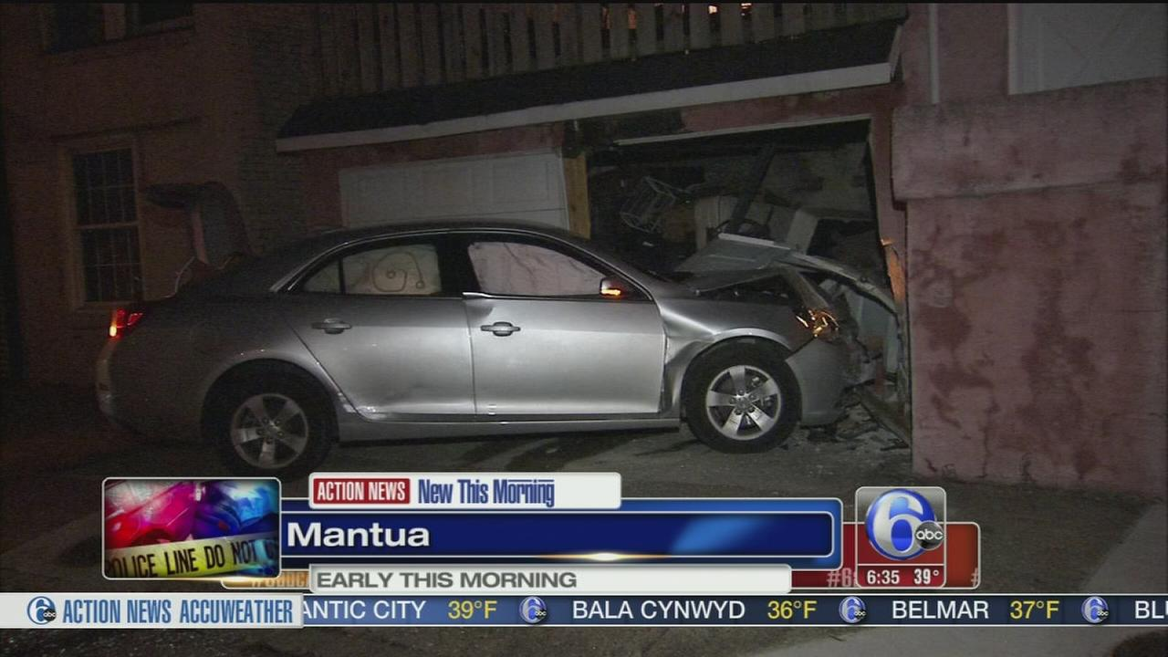 VIDEO: Car hits garage in Mantua