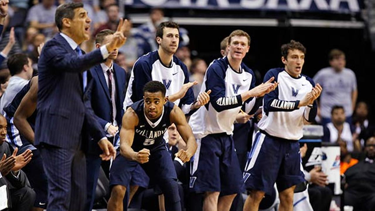 Villanova guard Phil Booth (5) and others react, with head coach Jay Wright, left, after a play during the second half of an NCAA college basketball game against Georgetown.
