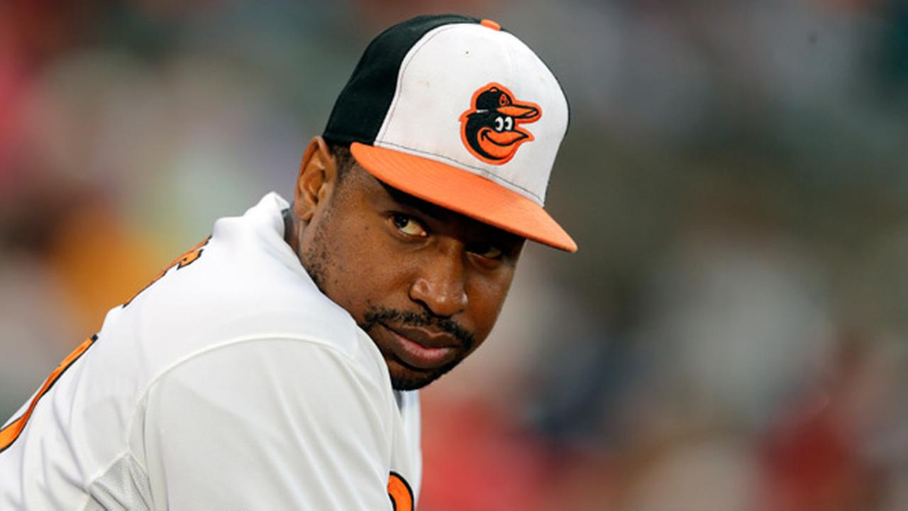 Baltimore Orioles Delmon Young looks out from the dugout during an interleague baseball game against the Philadelphia Phillies, Monday, June 15, 2015, in Baltimore.